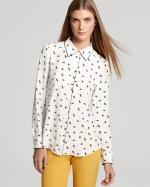 Mindy's white printed shirt at Bloomingdales at Bloomingdales