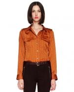 Orange blouse like Robins at Neiman Marcus