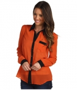 Orange shirt with contrasting collar at 6pm