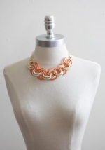 Orange statement necklace at Ruche at Ruche