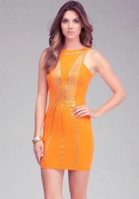 Orange studded open back dress at Bebe