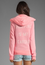 Pink hoodie with same text at Revolve
