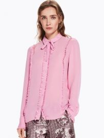 Pink ruffle blouse w bow at Fernweh