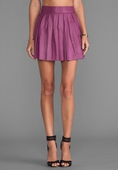 Pleated leather skirt in mulberry by Alice and Olivia at Revolve