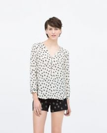 Printed top with front zip at Zara
