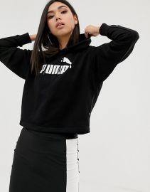 Puma Essentials cropped black hoodie at Asos