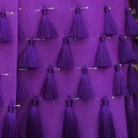 Purple tassel coat at Salvador Perez