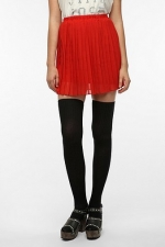 Red pleated skirt from Urban Outfitters at Urban Outfitters