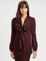 Regina's brown blouse at Saks Fifth Avenue