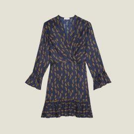 SHORT PRINTED DRESS WITH RUFFLES at Sandro