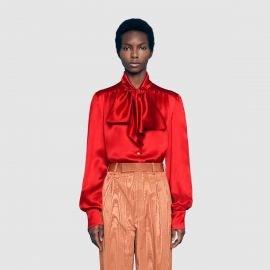 Satin shirt with neck bow at Gucci