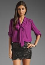 Similar purple blouse at Revolve