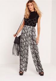Snake print wide leg trousers at Missguided