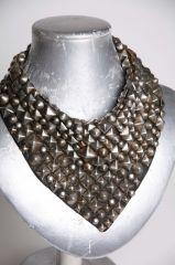 Studded leather bib at Nicolina Royale