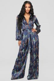 The Entertainer Satin Jumpsuit at Fashion Nova