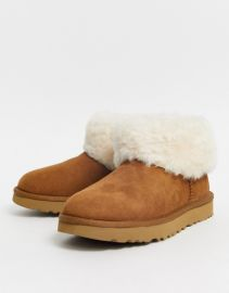 UGG Classic Mini Fluff ankle boots in chestnut at Asos