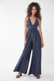 UO Gia Plunging Shimmer Jumpsuit at Urban Outfitters