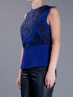 Victoria's blue top at Farfetch