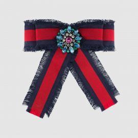 Web grosgrain bow brooch at Gucci