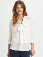 White blouse by Alice and Olivia at Saks Fifth Avenue