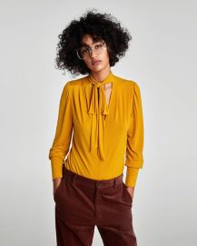 blouse with bow collar ochre at Zara