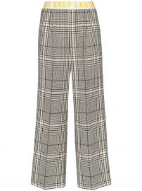 contrast stripe check trousers at Farfetch