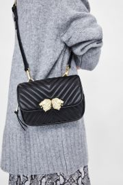 crossbody belt bag with lionhead detail at Zara