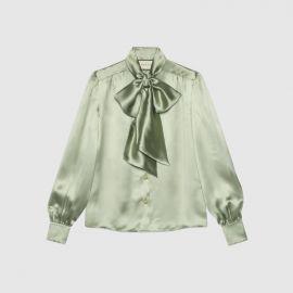 satin blouse at Gucci
